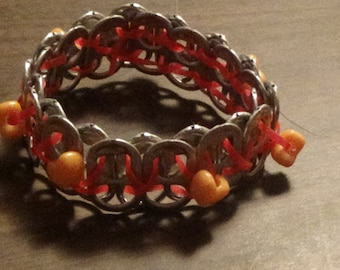 Orange with Hearts soda can tab bracelet.