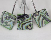 Decorative shower hooks in coastal blues, sparkly greens, purple, lavender and pearl polymer clay in mokume gane technique