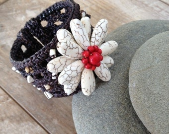 Handmade bracelet with white stone beads flower and red beads in the middle