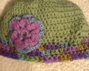 Moss green hat with purple accents.