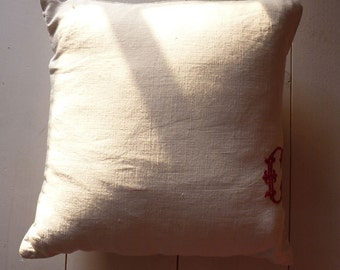Monogram C (right) cushion in old cloth