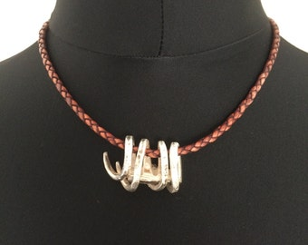 Braided leather necklace made of distressed leather, with pendant of silver fork