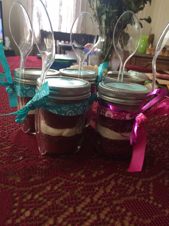 6 (8oz) Red velvet cupcake in a jar. I make variety of flavored cupcakes and design them for different occasions