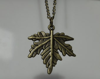 Maple leaf on antique brass chain. Pendant Bronze. The choice and choice of chain length.