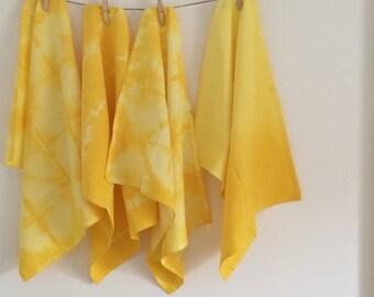 Shibori dyed yellow tea towel