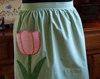 Half apron with tulip pocket detail