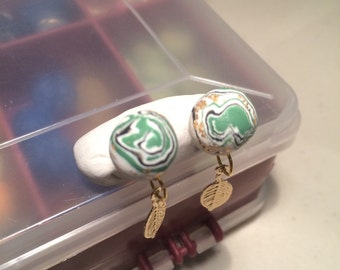 Green and gold studs with leaves