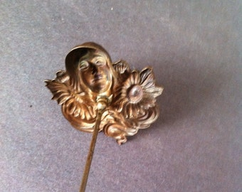 Old Brass Art Nouveau Hat Pin. Beautiful ladies face with flowers and flowing hair. Very NICE!