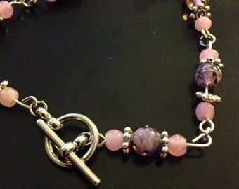 Pink and purple bracelet with daisy flower beads