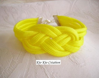 Costume jewel, mode(fashion), yellow bracelet sun, cordon braided flat textile fabric(tissue), chains of extension, silvered.