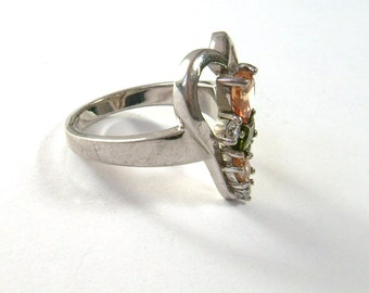 vintage silver ring with different colored gem stones