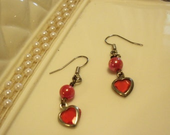red dangle earrings on hooks