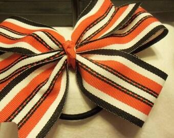 "5"" pinwheel bow on a elastic pony holder"