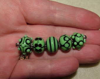 Nile green and Black - ready to ship handmade lampwork beads by K. Urato, SRA, LEteam