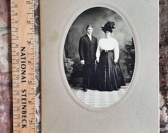 Vintage studio photo of couple. Antique studio photo of couple.