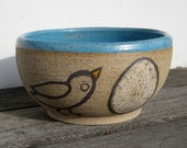 Serving Bowl with Bird and Egg Design in Sky Blue Glaze