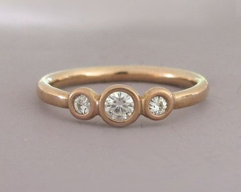 14k Rose Gold and Moissanite Engagement Ring - Three Stone Bezel