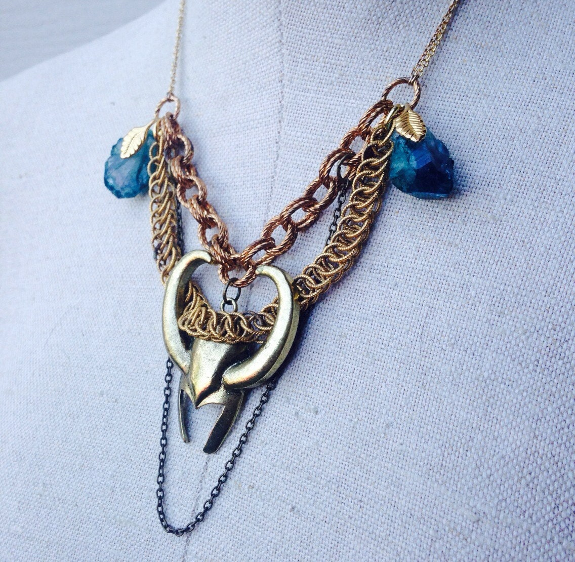 the trickster loki comic inspired necklace wirh by