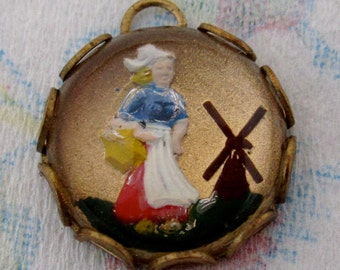 vintage reverse painted intaglio dutch girl in raw brass lace setting charm pendant 13mm - f4443