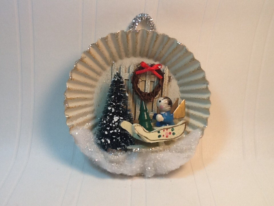 Vintage tin christmas ornament with wooden miniatures