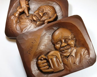 SJK VINTAGE -- Two Hand Carved Folk Art Wooden Wall Hangings of Old Man with Alcohol Beer Plenty and Drought  (1950's-70's)
