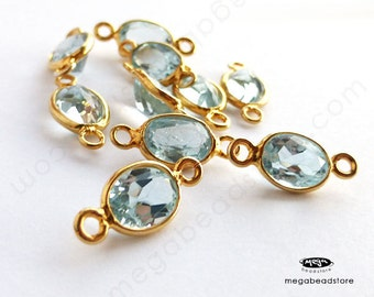 8 pcs 7mm x 5mm Blue Topaz Gold Bezel Oval Connectors F493