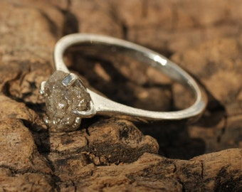 Rough diamond engagement ring in sterling silver band