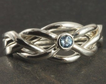 Infinity Puzzle ring in sterling silver with natural aquamarine