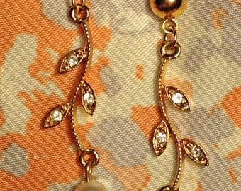 Gold branch post earrings with cz leaves