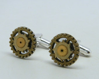 Steampunk jewelry cuff link with gears.