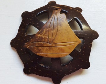 Vintage sailboat on ship's wheel brooch coconut shell carved wood pin or brooch nautical c-clasp