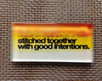Stitched together with good intentions. glass magnet