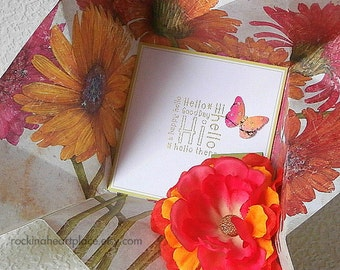 Folded Pinwheel HELLO Card in pink, orange, yellow and green with coordinating  flower