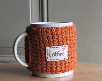Knitted coffee mug cozy cup cozy with hand embroidered patch in burnt pumpkin