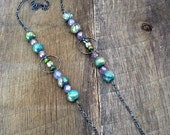 Geometric Painted Swirled Wood Bead and Czech Glass Necklace with Gunmetal Hammered Circles and Long Chain - purple green gold