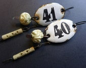 Order and Harmony. Rustic assemblage art earrings with white enameled plaques. 40/41