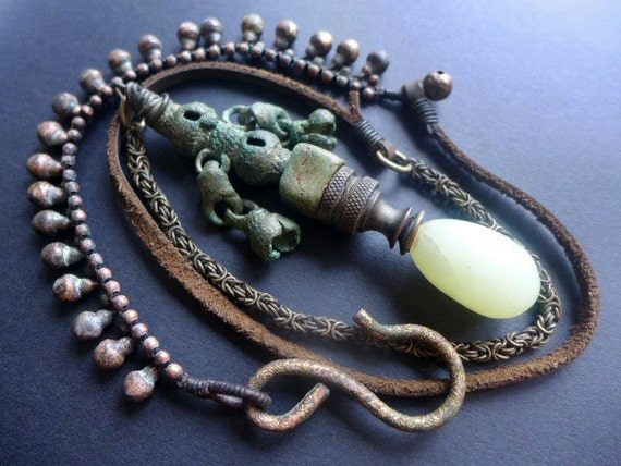 The Favors of the Moon. Long statement pendant necklace with finial and archaeological find.