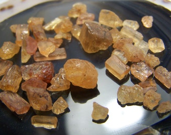Imperial Topaz crystals by the gram - tiny small pieces and chips yellow orange peach golden champage ouro preto brazil - inlay stones