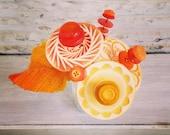 yellow, orange, red-orange button flower bottle bouquet
