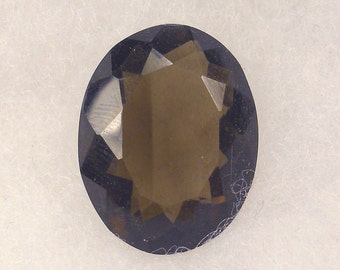 28 CT  ....  Faceted Smokey Quartz Gemstone ... 24 x 19 x 10  MM