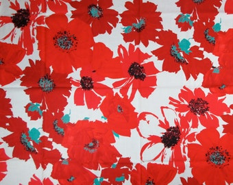 A just-under-one-yard cotton print remnant of stylized red flowers on a white ground