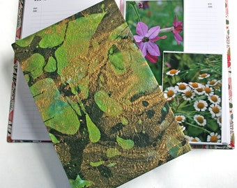 Garden Journal The Essentials covered with with hand marbled paper and coptic stitching