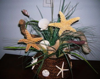 Starfish, Seashell and Driftwood Arrangement in a Shell Covered Rattan Bowl