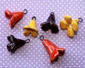 3 pc. Ceramic Flower Charm Set - one yellow, purple, red