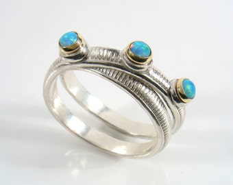 Sterling silver infinity shape, banded and oxidized with three 3 mm round cabochon stones , set in gold bezels.Engagement ring.promise ring.