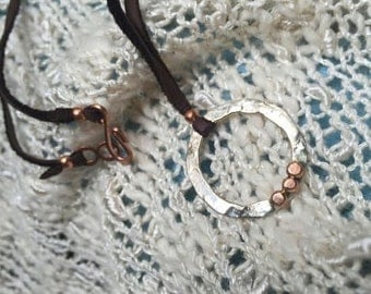 Circle dot necklace with buckskin cord in sterling and copper