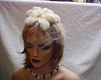 SALE.  White Rabbit Fur fascinator hat with white face veil
