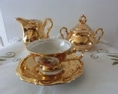 24 Kt Gold plaited creamer and sugar bowl plus demi cup