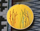 A Rainbow of Little Twigs - Hand Embroidered Hoop Art on Golden Yellow Felt