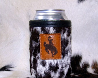Bucking Horse Accent On A Cowhide Leather Can Insulator - Black & White Speckled Cowhide Coolie